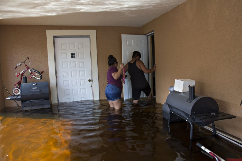 Residents enter their flooded home to collect personal belongings in Bonita Springs, Florida, after Hurricane Irma.